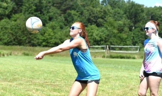 Zoe Mader sets the ball during a skills lesson Wednesday. The rising freshman at Stuarts Draft High School has been coming to Lofton Lake's volleyball camp for five years.