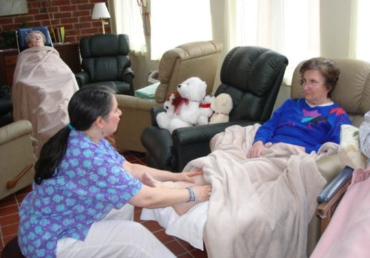 Dementia patient receives a foot rub as part of the Namaste Care.