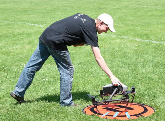 Chris Rohlfing, an unmanned aircraft systems contractor with Northland Community and Technology College, places a drone on a landing pad during the DroneTECH Educators Workshop Tuesday, July 16, 2019.