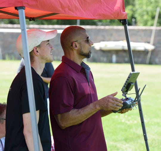 Chris Rohlfing, left, an unmanned aircraft systems contractor with Northland Community and Technology College, and Mario Hesse, Criminal Justice Graduate Program Director at St. Cloud State, pilot a drone during the DroneTECH Educators Workshop Tuesday, July 16, 2019.