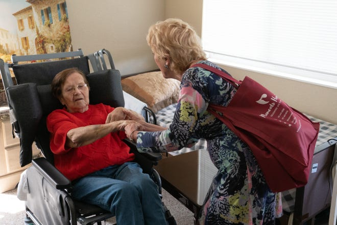 Joyce Simard meets with a patient during her visit for Moments Hospice.