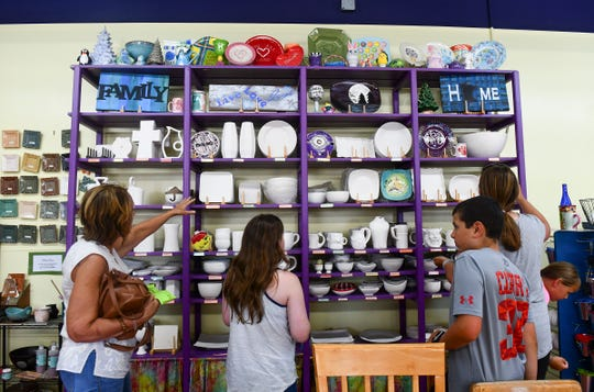 Customers pick out items for art projects Wednesday, July 17, 2019, at Art As You Like It in Waite Park.
