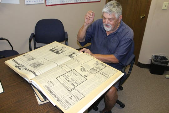 Long-time Princeton Union-Eagle columnist Luther Dorr looks over bound volumes of old newspapers looking for information to use about the 50th Annual  Princeton American Legion Baseball Tournament.