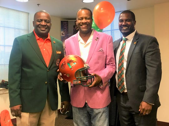 From left to right: FAMU NAA president Col. Greg Clark, Ron Fry and football head coach Willie Simmons share a moment in Dallas during the Willenium Tour.