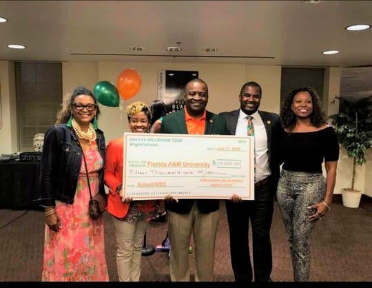 From left to right: LaShante Williams, Angelia Williams, FAMU NAA president Col. Greg Clark, FAMU football head coach Willie Simmons and Tamela Hartsfield pose with a $15,000 check in Dallas during the Willenium Tour. The Dallas-Fort Worth FAMU alumni chapter has since raised additional funds to push the donation over $16,000.