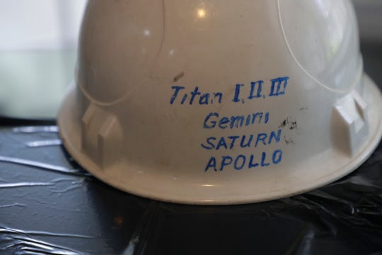 Duane Mitchell still has his old hardhat from his time working for General Electric at the Kennedy Space Center.
