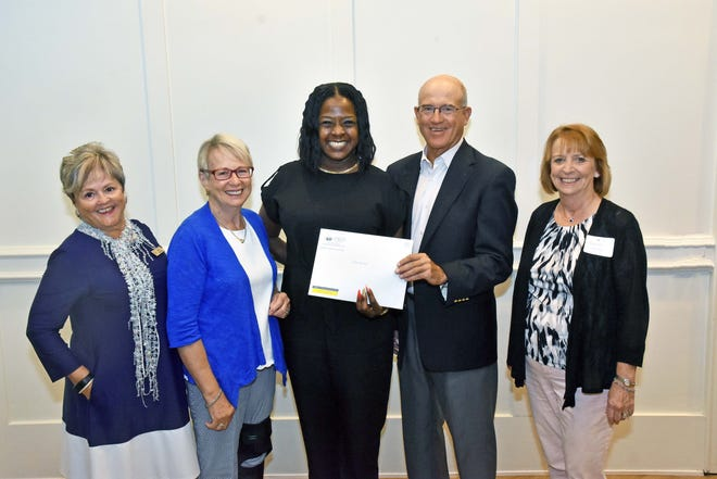 Miss B's Learning Bee's Executive Director LaToya Bullard, center, accepts a $6,500 grant from the Grand Harbor Community Outreach Program. Bullard is accompanied by, from left Tina Wilcox, Megs Phipps, James Otness and Maureen Landry.