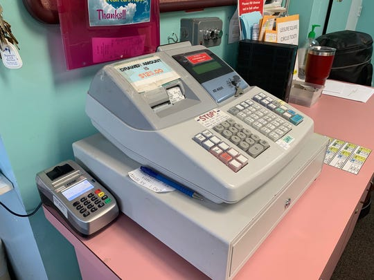 A cash register and a portable credit card reader, shown July 17, 2019, are the point-of-sale system for Leisure Square staff, which can't take reservations or credit cards online.