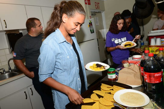 Ken Pruitt Unit member Elyse fixes lunch during a visit to St. Lucie Fire District's Station 12 in Port St. Lucie.