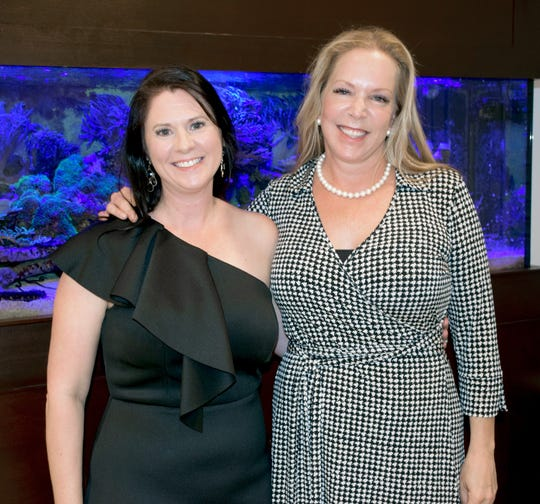 Kelly Sartain, left, and Event Host Tracey Zudans at the Words From War fundraising reception at the Zudans' barrier island home.