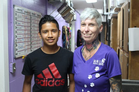 Indian River County Boys & Girls Club member Emanuel, left, with Jennifer Moyer, a H.A.L.O. No-Kill Rescue veterinarian technician.
