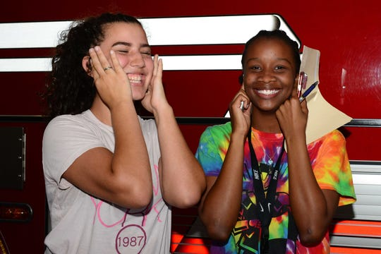 Ken Pruitt Unit members Gabriela, left, and Jessica prepare for the ringing of the truck sirens during a visit to St. Lucie Fire District's Station 12 in Port St. Lucie.
