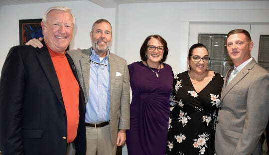 Marty Zickert, left, Bruce Cady, Patty Ryan, Leydiana Collins and Matthew Scheidel attend the fundraising reception for the Words From War monument.
