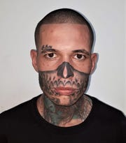 Carlos Manuel Gonzalez Chavez, who has a skull face tattoo, was convicted in an armed robbery in Chihuahua City, Mexico.