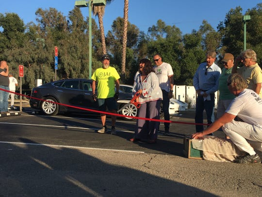 Ojai Mayor Pro Tempore Suza Francina cuts the ribbon for a bank of new Tesla chargers in Ojai.
