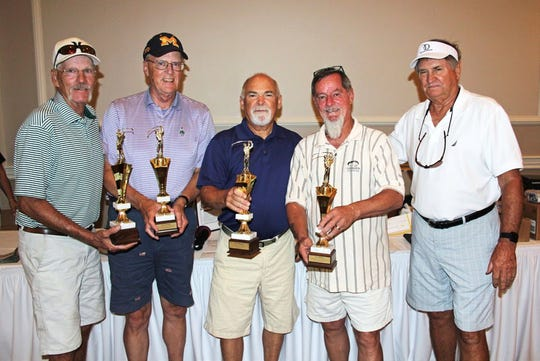 Robin Daplyn, trustee and golf tournament director of The Guidance Center (right), congratulates first place winners of the center's seventh annual golf tournament fundraiser. Members of the winning team are: (from left) Terry Nugent, John Gasparon, Bob Conner and Glen Ewan.
