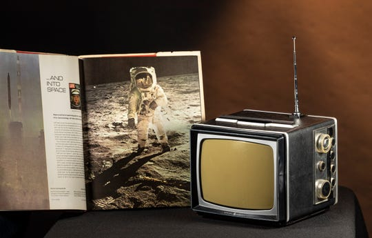 The General Electric B&W television from 1960s that Times-Delta photographer Ron Holman's family watched the 1969 moon landing on. It was powered by AC, a cigarette lighter adapter, or a separate battery pack almost as big as the 13-pound TV itself.
