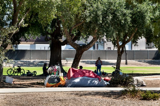 A new ordinance in Visalia will require these tents in Seven Oaks Park and other parks to be taken down by 6 a.m. Photo taken on Wednesday, July 17, 2019