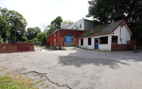 The site of adjoining parcels at 1 Vanderbilt Ave. and 52 Depew St., where a 73-unit apartment building with first-floor retail and underground parking is proposed close to downtown Pleasantville, July 17, 2019.