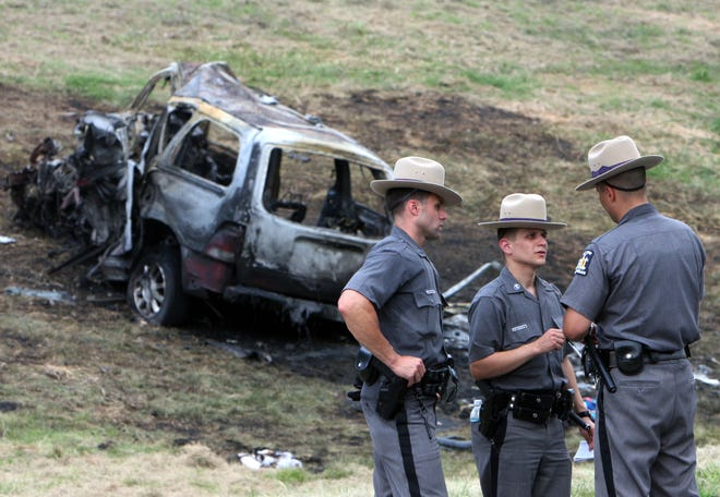 New York State troopers work at the scene of a fatal accident in which 8 people were killed on the Taconic Parkway in Hawthorne on July 26, 2009, when Diane Schuler drove her minivan south in the northbound lanes.
