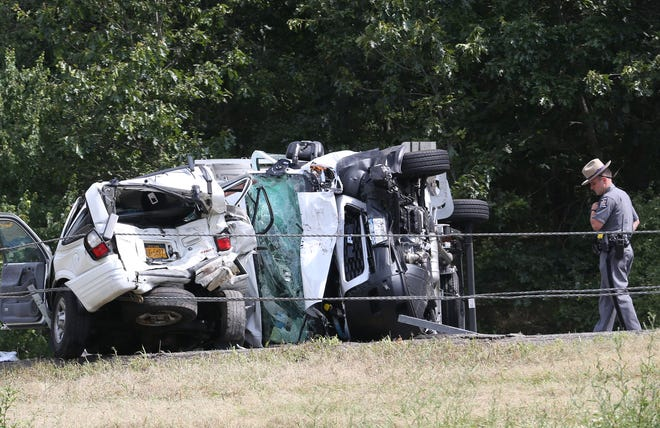 A New York State Trooper looks over the scene of a 2-car accident that has shut Interstate 84 westbound in the town of Southeast July 17, 2019. The drivers of both vehicles were transported to Danbury Hospital.