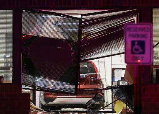 A Honda SUV rests inside an Ogletown corporate center office after its driver lost control and drove into the building shortly before 10 p.m. Tuesday.
