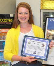 Alison Olsen received the Scholarship for Military Children, Wednesday afternoon during a ceremony celebrating the acceptance for the $2,000 scholarship that will go toward continued education this fall.