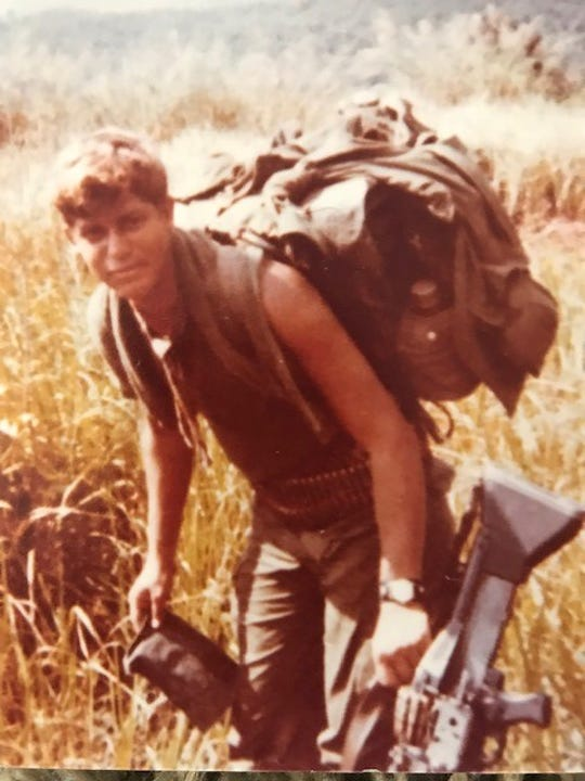 Steve Critchelow is seen in a photo from 1970 or 1971 during his tour in Vietnam. He was a machine gunner during the war. He and other members of his former squad are looking for men they served with.