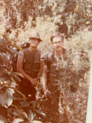 A photo taken in 1970 or 1971 during the Vietnam War shows two soldiers. The one on the left has the last name Jackson and the one on the right was named Bailey. A fellow solider, now living in Kentucky, is looking for the man. He believes Jackson was from Wichita, Kansas, or Wichita Falls.