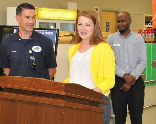Alison Olsen,centered, received the Scholarship for Military Children, Wednesday afternoon during a ceremony celebrating the acceptance for the $2,000 scholarship that will go toward continued education this fall.