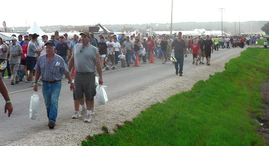 The big crowd quietly leaves the Gerrits farm in 2008 when the show was closed as a storm approached.