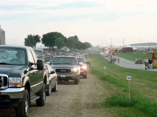A long line of cars leaving the 2008 Farm Tech Days at about 2 pm on Wednesday of the 2008 show.