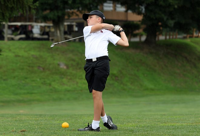 Noah Dever, 12, of New Concord, tees off during the ZDGA 14u golf tournament at Green Valley Golf Course Wednesday morning.