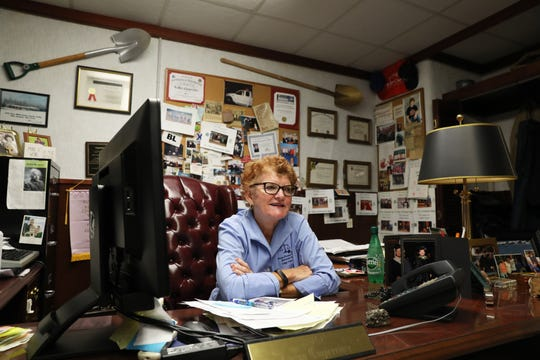 Perry County Juvenile/Probate Judge Luann Cooperrider in her office, surrounded by momentos of her long career.