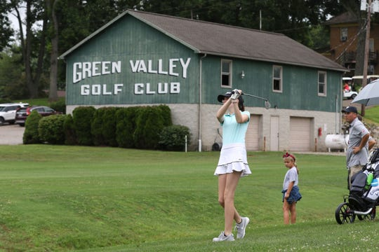 Hannah Huggins, 12, of Granville hits a shot during the ZDGA 14u golf tournament at Green Valley Golf Course Wednesday morning.