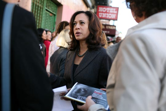 In this 2008 photo, then-San Francisco District Attorney Kamala Harris speaks to supporters before a press conference on a ballot measure on prostitution. Harris used her hands-on politicking skills to beat a legendary incumbent, Terrence Hallinan, and become the first woman in the DA post.