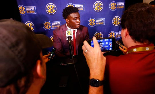Alabama linebacker Dylan Moses speaks to reporters during SEC Media Days.