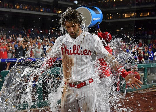 July 16: Philadelphia Phillies shortstop Jean Segura soaks right fielder Bryce Harper after Harper hit a two-run walk-off RBI double in the ninth to beat the Los Angeles Dodgers 9-8 at Citizens Bank Park.