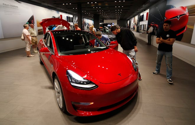 Tesla Elon Musk Cuts Price Of Model 3 Discontinues Model S