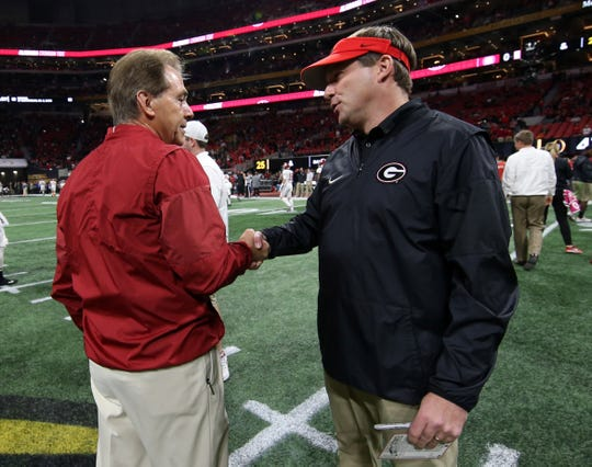 Alabama coach Nick Saban, left, shakes hands with Georgia  coach Kirby Smart before the College Football Playoff championship game on Jan. 8, 2018.