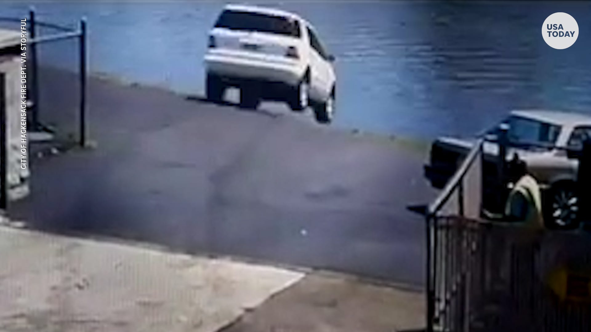 SUV exits car wash, plunges into river