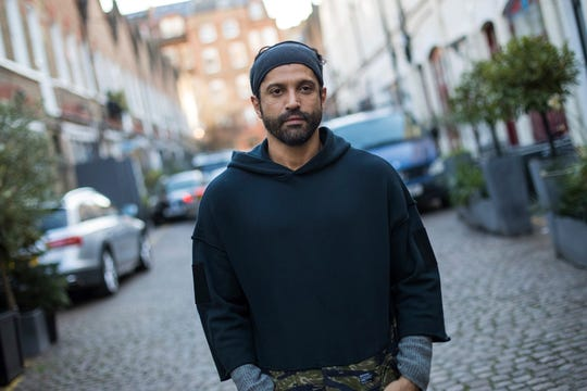 """In this Feb 7, 2019, photo, actor and U.N. """"He for She"""" Ambassador Farhan Akhtar poses for a portrait photograph in London."""