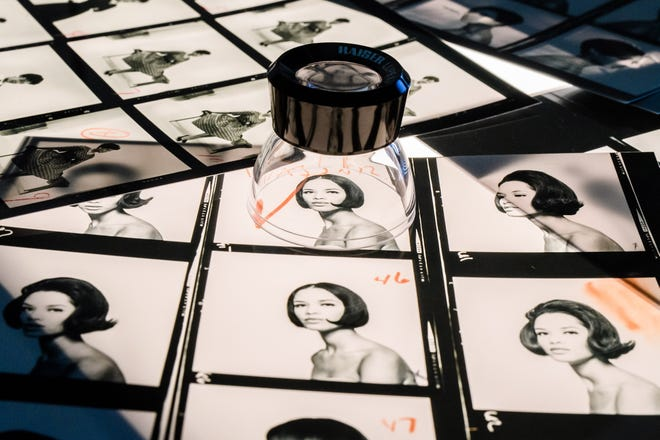 epa07524890 A light table with contact sheets on display during a press preview of the exhibition 'The Black Image Corporation' by Theaster Gates at the Martin Gropius Bau museum in Berlin, Germany, 24 April 2019.
