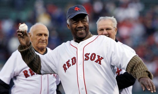 """Elijah """"Pumpsie"""" Green throws out a ceremonial first pitch for Boston's game against the Orioles."""