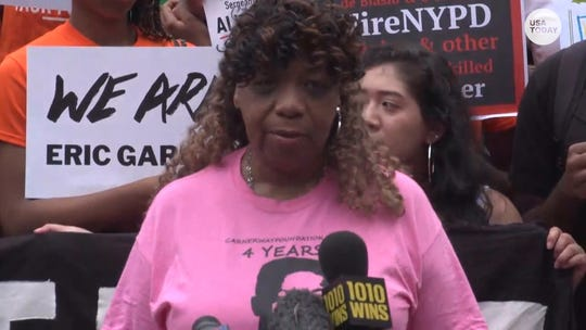 'We are fighting for justice': Protesters call for firing of NYPD officers at 'We are Eric Garner' rally