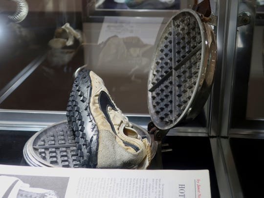 """A Nike """"Moon Shoe"""" is on display at Sotheby's auction house in New York on July 12, 2019."""