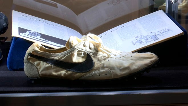 This image taken from video shows the Nike handmade Moon Shoe, designed by Nike co-founder Bill Bowerman in 1972, on display in New York on Friday, July 12, 2019.