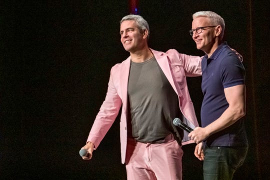 "Andy Cohen, left, and Anderson Cooper participate in ""AC2: Deeper Talk & More Shallow Tales"" on  June 22, 2019, in New York."