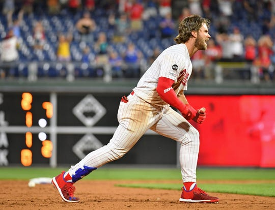 Jul 16, 2019: Bryce Harper (3) celebrates his walk-off RBI double during the ninth inning against the Los Angeles Dodgers  at Citizens Bank Park.