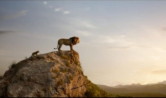 "Simba (left) and Mufasa survey their vast kingdom in ""The Lion King."""